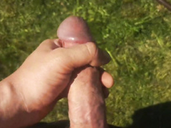 The nasty beauty masturbates her cute sinistral pussy and squirts in the yard